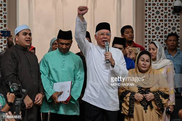 Malaysia's former prime minister Najib Razak shouts slogans after taking part in a sumpah laknat a rare prayer calling on god for divine retribution...