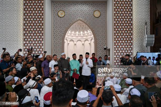 Malaysia's former prime minister Najib Razak speaks before taking part in a sumpah laknat a rare prayer calling on god for divine retribution against...