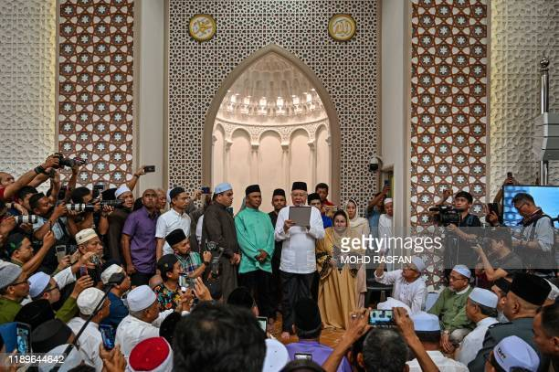 Malaysia's former prime minister Najib Razak takes part in a sumpah laknat a rare prayer calling on god for divine retribution against elite Special...