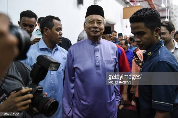 Malaysia's former prime minister Najib Razak walks after Friday prayers at the Barisan Nasional party headquarters in Kuala Lumpur on May 18 2018...