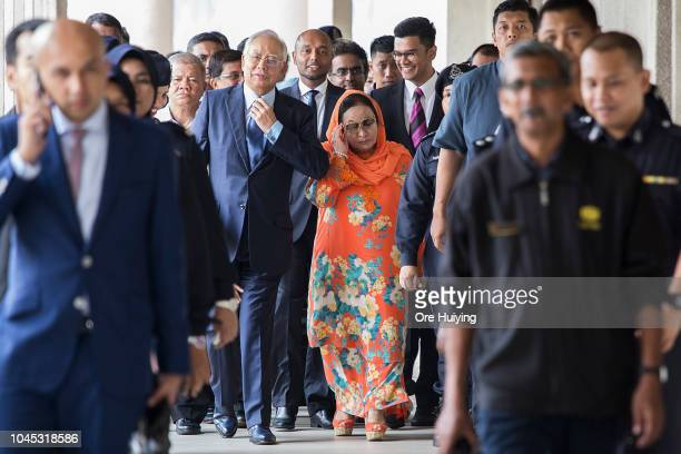 Malaysia's former Prime Minister Najip Razak departs the Kuala Lumpur High Court with his wife Rosmah Mansor on October 4 2018 in Kuala Lumpur...