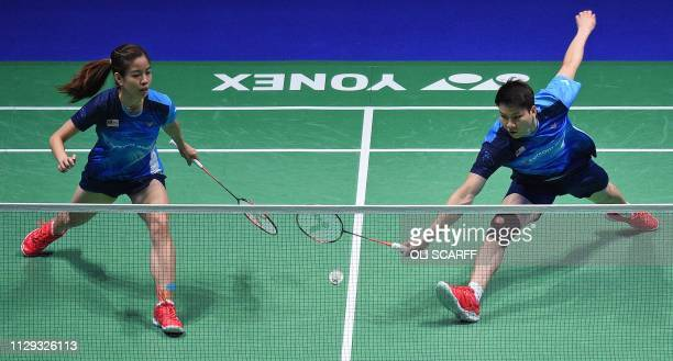 Malaysia's Goh Soon Huat and Lai Shevon Jemie okay against Japan's Yuta Watanabe and Arisa Higashino in the mixed doubles semi final of the All...