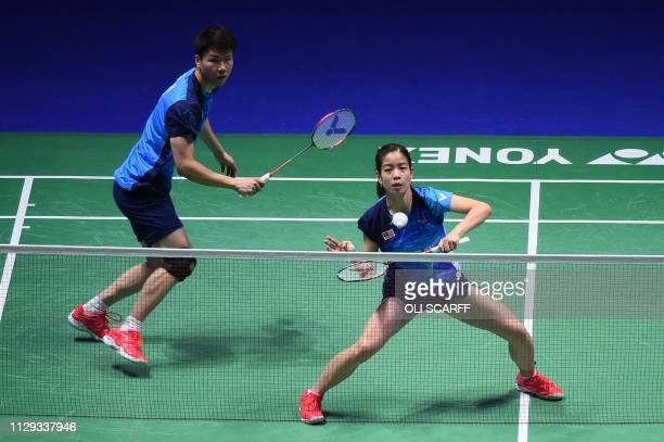 Malaysia's Goh Soon Huat and Lai Shevon Jemie play against Japan's Yuta Watanabe and Arisa Higashino in the mixed doubles semi final of the All...