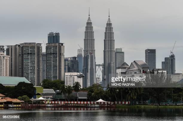 Malaysia's iconic landmark Petronas Twin Towers domninates the skyline of Kuala Lumpur on June 26, 2018.