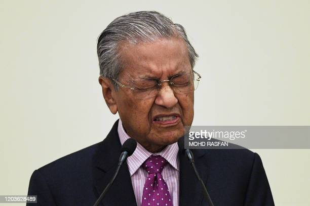 Malaysia's interim Prime Minister Mahathir Mohamad answers questions during a press conference after unveiling an economic stimulus plan aimed at...