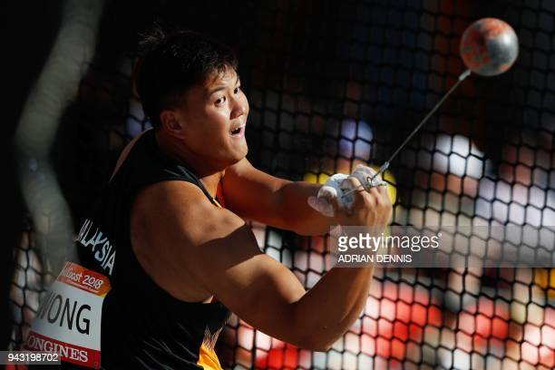 Malaysia's Jackie Siew Cheer Wong competes in the athletic's men's hammer throw final during the 2018 Gold Coast Commonwealth Games at the Carrara...