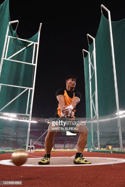 Malaysia's Jackie Wong competes in the final of the men's hammer throw athletics event during the 2018 Asian Games in Jakarta on August 26 2018