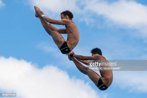 TOPSHOT Malaysia's Jellson Jabillin and Hanis Nazirul Jaya Surya compete in the men's synchronised 10m platform diving in the 2018 Gold Coast...