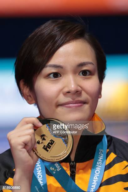 Malaysia's Jun Hoong Cheong poses with her gold medal during the podium ceremony for the women's 10m platform final during the diving competition at...