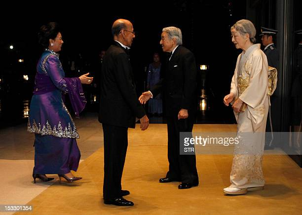 Malaysia's King Abdul Halim Mu'adzam Shah and his wife Queen Haminah Hamidun are welcomed by Japanese Emperor Akihito and Empress Michiko upon their...