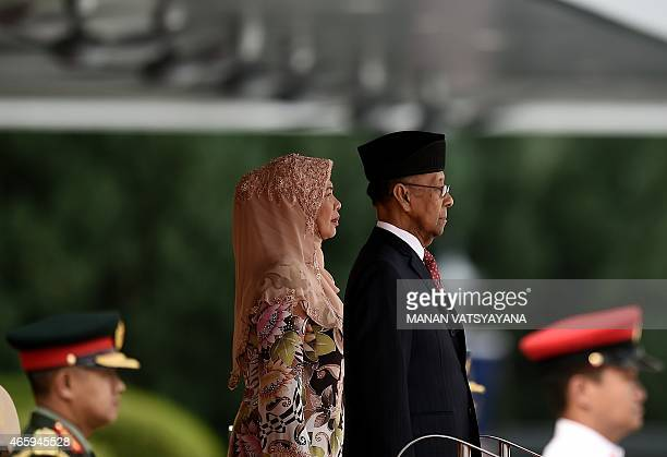 Malaysia's King Abdul Halim Mu'adzam Shah arrives to take part in welcome ceremony of visiting Myanmar President at the Parliament in Kuala Lumpur on...