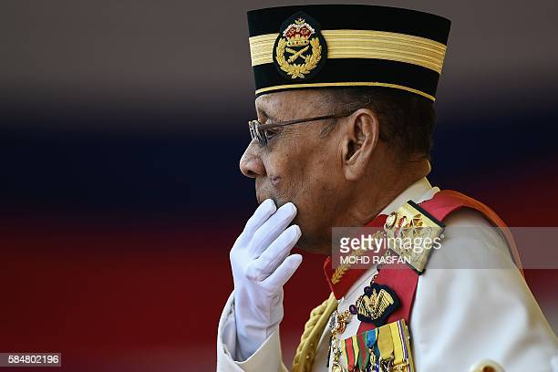 Malaysia's King Abdul Halim Mu'adzam Shah gestures during the Warriors' Day Celebration in Putrajaya, outside Kuala Lumpur on July 31, 2016. Malaysia...