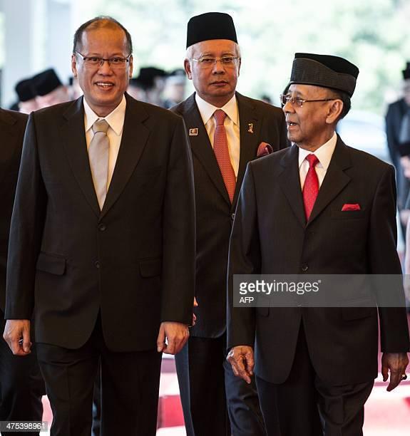 Malaysia's King Abdul Halim Mu'adzam Shah , Philippine President Benigno Aquino and Malaysian Prime Minister Najib Razak walk after a welcoming...