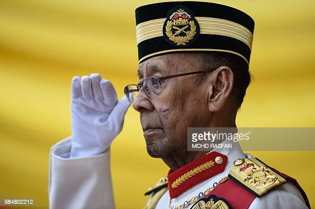 Malaysia's King Abdul Halim Mu'adzam Shah salutes as he arrives for the Warriors' Day Celebration in Putrajaya outside Kuala Lumpur on July 31 2016...