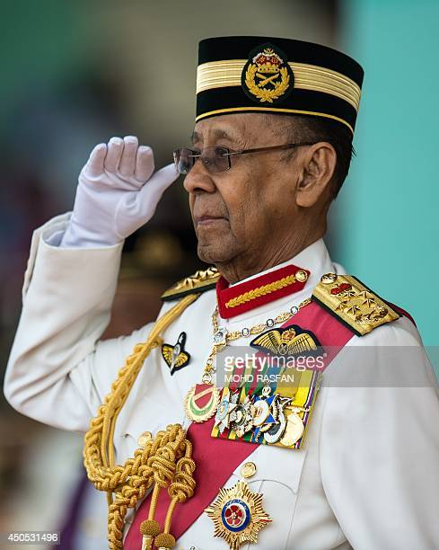 Malaysia's King Abdul Halim Mu'adzam Shah salutes honour guards during his official birthday celebration in Kuala Lumpur on June 13 2014 King Abdul...