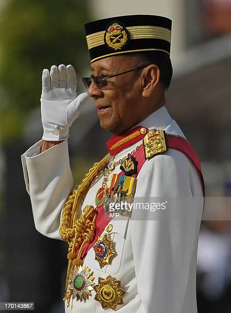 Malaysia's King Abdul Halim Mu'adzam Shah salutes to the honour guards during his official birthday celebration in Kuala Lumpur on June 8 2013 King...