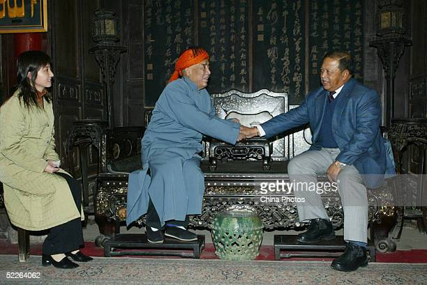Malaysia's King Syed Sirajuddin Syed Putra Jamalullail shakes hands with Imam Ma Liangji at Great Mosque during his visit to Xian on March 2 2005 in...