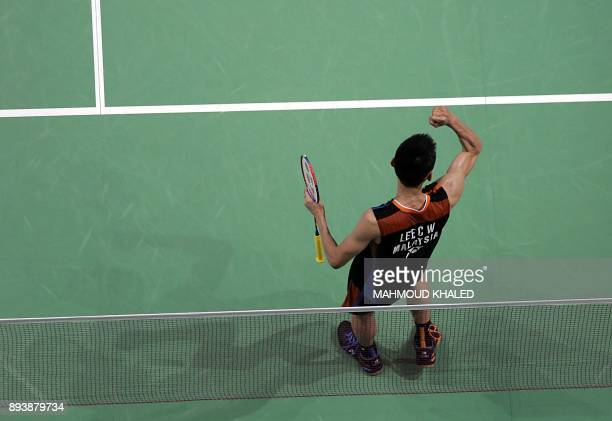 Malaysia's Lee Chong Wei celebrates after beating South Korea's Son Wan Ho in their semifinal match during the Dubai Badminton World Superseries...