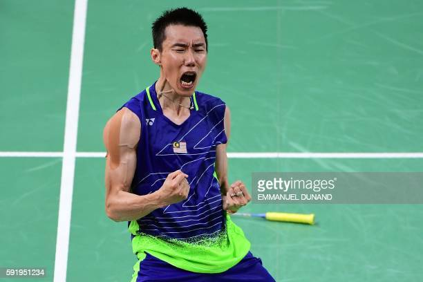 TOPSHOT Malaysia's Lee Chong Wei reacts after winning against China's Lin Dan during their men's singles semifinal badminton match at the Riocentro...