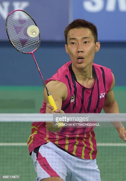 Malaysia's Lee Chong Wei returns a shot against India's Parupalli Kashyap during their men's singles second round badminton match at the 2014 Asian...