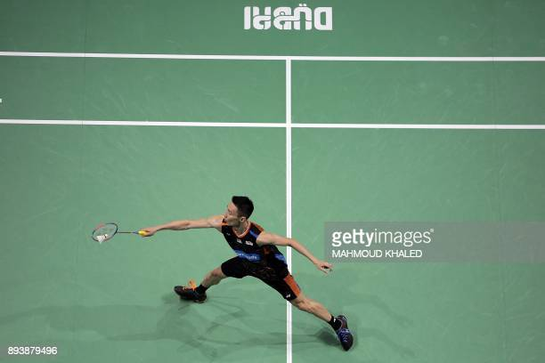 Malaysia's Lee Chong Wei returns a shot to South Korea's Son Wan Ho during their semifinal match during the Dubai Badminton World Superseries Finals...