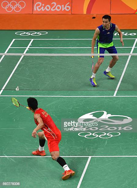 Malaysia's Lee Chong Wei returns to China's Chen Long during their men's singles Gold Medal badminton match at the Riocentro stadium in Rio de...