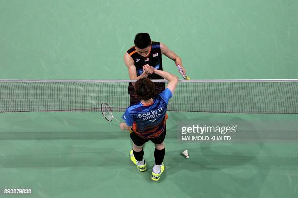 Malaysia's Lee Chong Wei shakes hands with South Korea's Son Wan Ho after winning their semifinal match during the Dubai Badminton World Superseries...