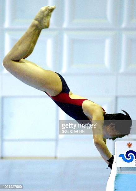 Malaysia's Leong Mun Yee takes off from the platform during the women's 10m platform diving final at the 14th Asian Games in Busan 12 October 2002...