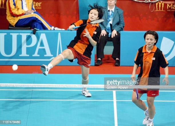 Malaysia's Li Peng Ang plays a return with Pek Siah Lim against New Zealand's Sara Petersen Runesten and Nicole Gordon 04 August 2002 in the...