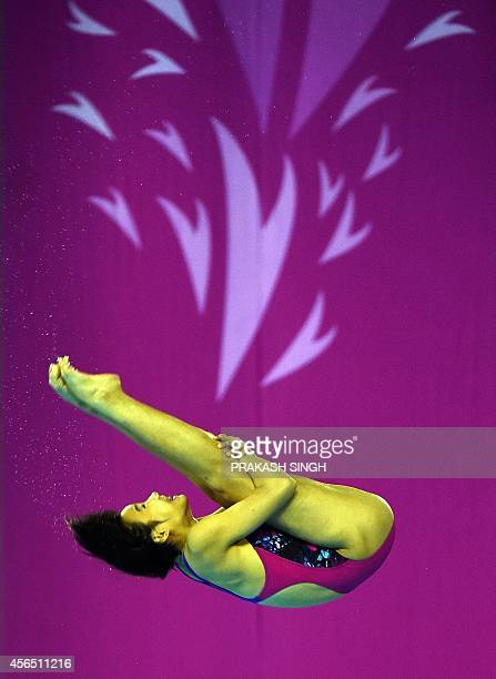Malaysia's Loh Zhiayi performs during the women's 10m platform diving final of the 2014 Asian Games at the Munhak Park Taehwan Aquatics Center in...