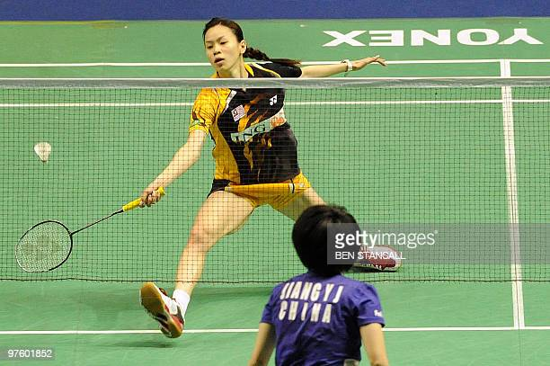 Malaysia's Mew Choo Wong returns a shot to China's Yanjiao Jiang during their woman's singles first round match at the Badminton All England Open...