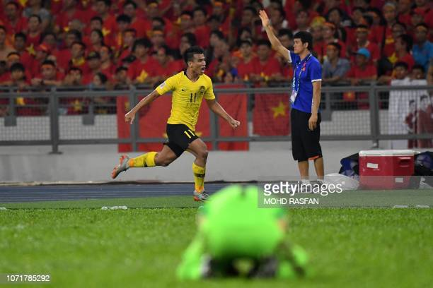 Malaysia's midfielder Safawi Rasid celebrates after scoring an equalizer during the AFF Suzuki Cup 2018 final football match between Malaysia and...