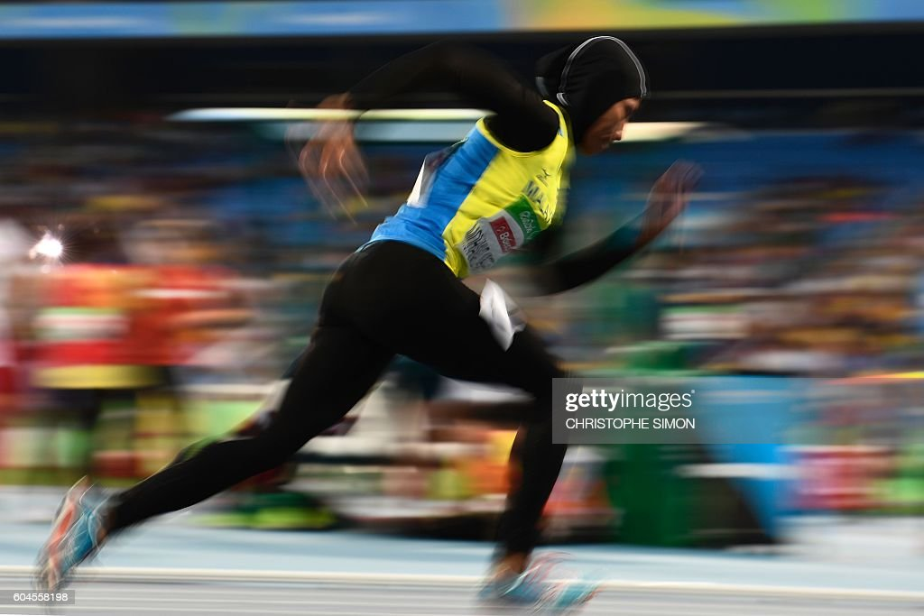 TOPSHOT - Malaysia's Mohamad Ariffin Siti noor Iasah competes in the Women's 400M race at the Olympic Stadium during the Rio 2016 Paralympic Games in Rio de Janeiro, Brazil, on September 13, 2016. / AFP / CHRISTOPHE