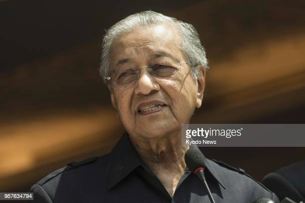 Malaysia's newly elected Prime Minister Mahathir Mohamad announces in a press conference in Kuala Lumpur on May 11 that the king has consented to...