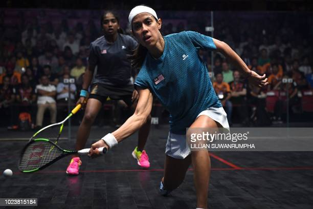 Malaysia's Nicol Ann David returns a shot against Malaysia's Sivasangari Subramaniam during the final of the women's singles squash event at the 2018...