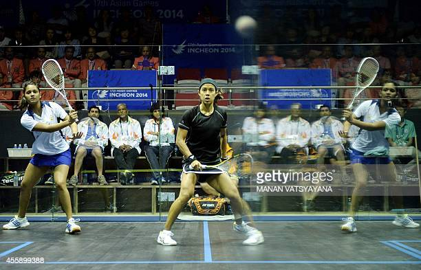 Malaysia's Nicol Ann David watches a shot from India's Dipika Pallikal during the women's squash semifinal match of the 2014 Asian Games at the...