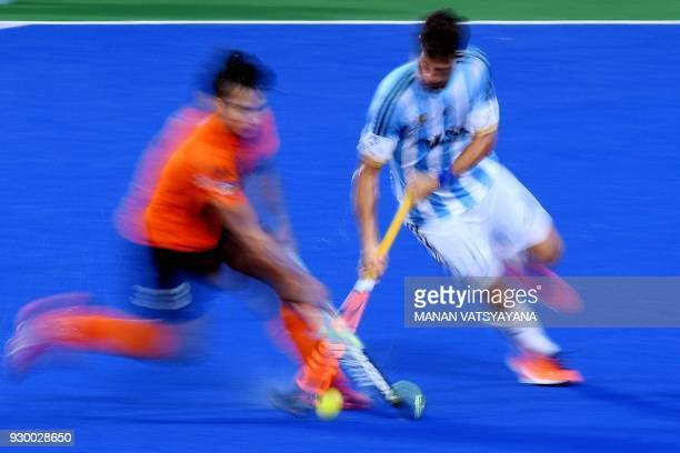 Malaysia's Norsyafiq Sumantri challenges Juan Lopez of Argentina during their men's field hockey thirdfourth place match of the 2018 Sultan Azlan...