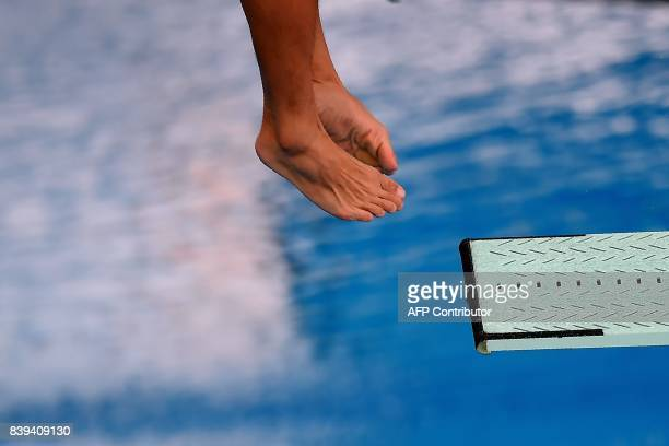 Malaysia's Ooi Tze Liang competes in the men's diving 3m springboard final of the 29th Southeast Asian Games at the National Aquatics centre in Kuala...
