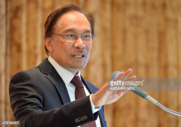 Malaysia's opposition leader Anwar Ibrahim delivers a speech during a lecture hosted by Japan's Sasakawa Peace Foundation in Tokyo on February 27...
