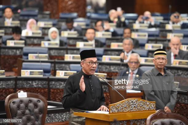 Malaysia's People's Justice Party president and leader of the Pakatan Harapan coalition Anwar Ibrahim takes an oath as a member of the parliament...
