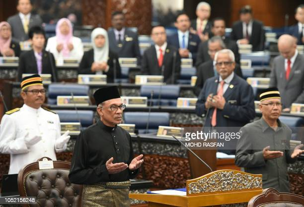 Malaysia's People's Justice Party president and leader of the Pakatan Harapan coalition Anwar Ibrahim prays before taking an oath as a member of the...