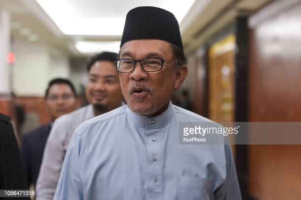 Malaysia's People's Justice Party president and leader of the Pakatan Harapan coalition Anwar Ibrahim arrives at the parliament house for tabling of...