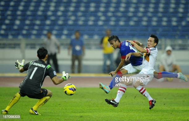 Malaysia's player Khyril Muhymeen Zambri scores a goal against Laos during their AFF Suzuki Cup group B football match in Bukit Jalil Stadium outside...