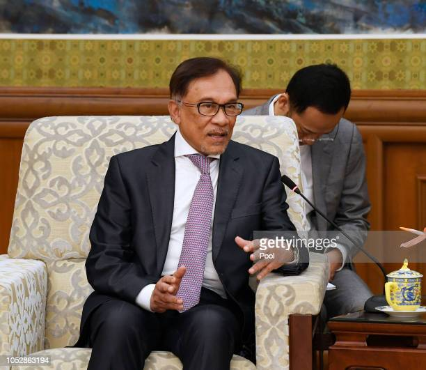 Malaysia's politician Anwar Ibrahim speaks to Chinese State Councilor and Foreign Minister Wang Yi not shown during a meeting at the Diaoyutai State...
