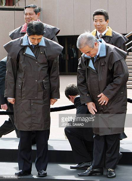 Malaysia's Prime Minister Abdullah Ahmad Badawi sets his Driza Bone a Australian traditional riding coat as Japan's Prime Minister Shinzo Abe...