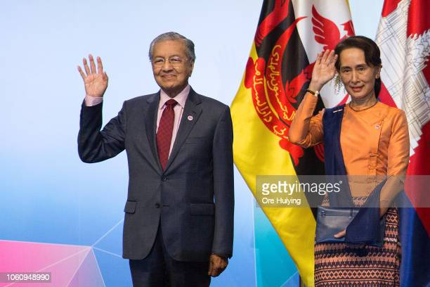 Malaysia's Prime Minister Mahathir Mohamad and Myanmar's State Counsellor Aung San Suu Kyi pose for a photo at the opening ceremony of the 33rd...