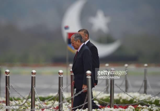 Malaysia's Prime Minister Mahathir Mohamad arrives to attend the Pakistan Day parade in Islamabad on March 23 2019 Pakistan National Day commemorates...