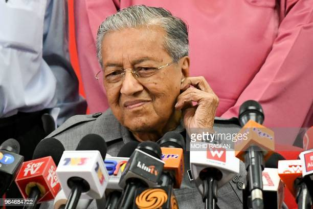 Malaysia's Prime Minister Mahathir Mohamad listens to questions from a journalist during a press conference in Kuala Lumpur on June 1 2018