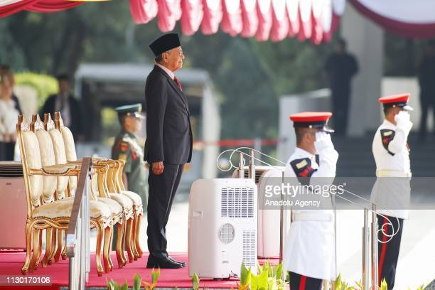Malaysia's Prime Minister Mahathir Mohamad pays respect to guard of honour prior to the welcoming ceremony of President of South Korea Moon Jaein at...
