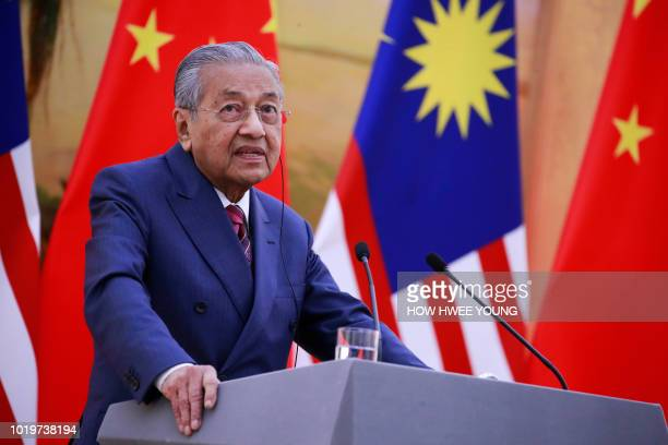 Malaysia's Prime Minister Mahathir Mohamad speaks during a joint press conference with China's Premier Li Keqiang at the Great Hall of the People in...